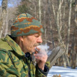 Man smoking in forest — Stock Photo #16517721