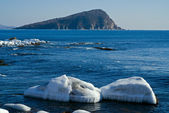 Small island in winter sea — Stock Photo