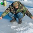 Man on winter fishing — Stock Photo