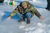 Man on winter fishing — Stock Photo