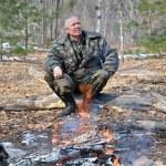 Man at bonfire — Stock Photo #22176159