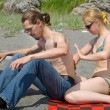 Young man and woman on beach — Stock fotografie