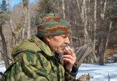 Man smoking in forest — Stock Photo