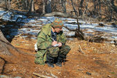 Zoologist in taiga — Photo