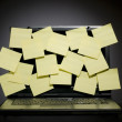 Laptop full of post it — Stockfoto