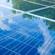 Solar panels with tree reflection — Stock Photo #12621402