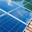 Solar panels on roof with green reflection — Stockfoto