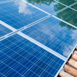 Solar panels on roof with green reflection - Stok fotoğraf