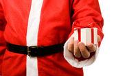 Santa Claus holding a gift — Stock Photo