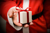 Santa Claus with gift — Stockfoto