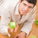 Man eating apples — Stock Photo