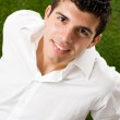 Young man on grass — Stock Photo #12655957