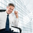 Smiling satisfied businessman — Stock Photo