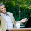 Foto Stock: Happy businessman outdoor