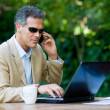 Businessman working outdoor - Stock Photo