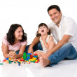 Happy family playing with blocks — Stok fotoğraf