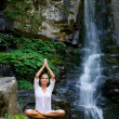 Young woman doing yoga in the nature — Stock Photo