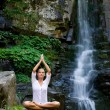 Young woman doing yoga in the nature — Foto Stock