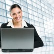 Business woman working on laptop — Stock Photo #12656893