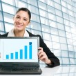 Business woman showing growing chart — Stock Photo #12656898