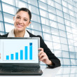 Stock Photo: Business womshowing growing chart