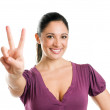 Young woman with victory sign — Stock Photo