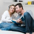 Royalty-Free Stock Photo: Young couple listening music together