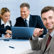 Stock Photo: Satisfied businessman with colleagues
