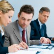 Business team analyzing documents — Stockfoto