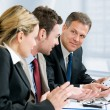 Stock Photo: Business team and growing chart