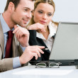 Working together on laptop — Stock Photo #12657741