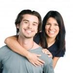 Smiling young latin couple piggyback — Stock Photo #12658103
