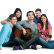 Happy group of friends playing guitar - Stock Photo
