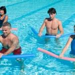 Aquagym exercise with tube — Stock Photo