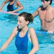 Fitness exercise in water swimming pool — 图库照片