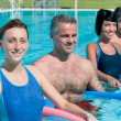 Smiling fitness exercising in swimming pool — Stock Photo