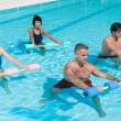 Aqua gym fitness exercise with water dumbbell - Stock Photo