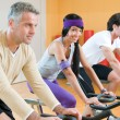 Spinning excercise group at gym - Stock Photo
