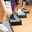 Foto Stock: Aerobic step exercise detail