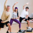 Foto Stock: Aerobic exercises at gym