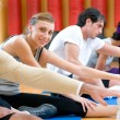 Aerobic stretching exercises at gym — Stock Photo