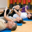 Stock Photo: Stretching exercises at gym