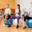 Exercising with fitness ball - Stock Photo