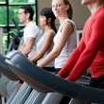 Treadmill exercises at gym — Stock Photo