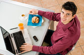 Businessman at work with breakfast — Stock Photo