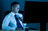 Businessman working till late — Stock Photo