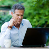 Businessman on laptop — Stock Photo