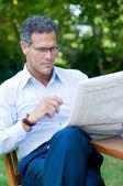 Mature man reading news — Stock Photo
