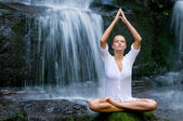 Woman doing yoga in the nature — Stock Photo