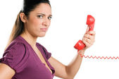 Surprised young woman on the phone — Stock Photo